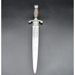 Puñal tipo daga Fabrica de Toledo 1858 ébano y escudo isabelino